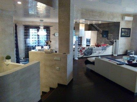 Pavimenti in resina pavimenti decorativi in resina for Pavimenti per cucina e soggiorno